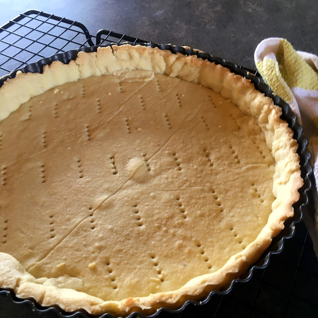 Sweet butter shortcrust pastry after it has been blind baked in a tart tin